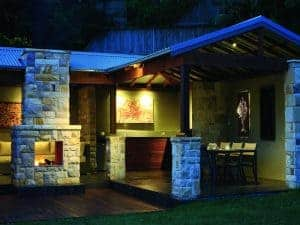 backyard-outdoor-living-area-stone-wall-fire-place-landscaping