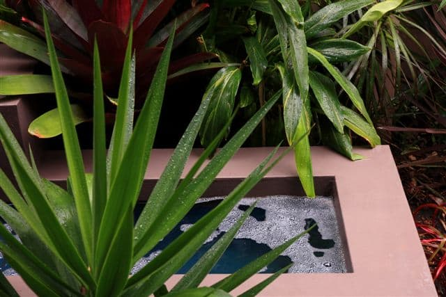 stepped-landscaping-hilly-garden-water-fountain-gallery7