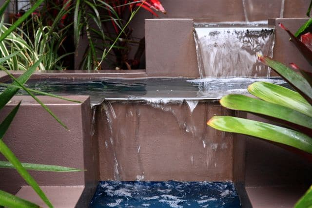 stepped-landscaping-hilly-garden-water-fountain-gallery8